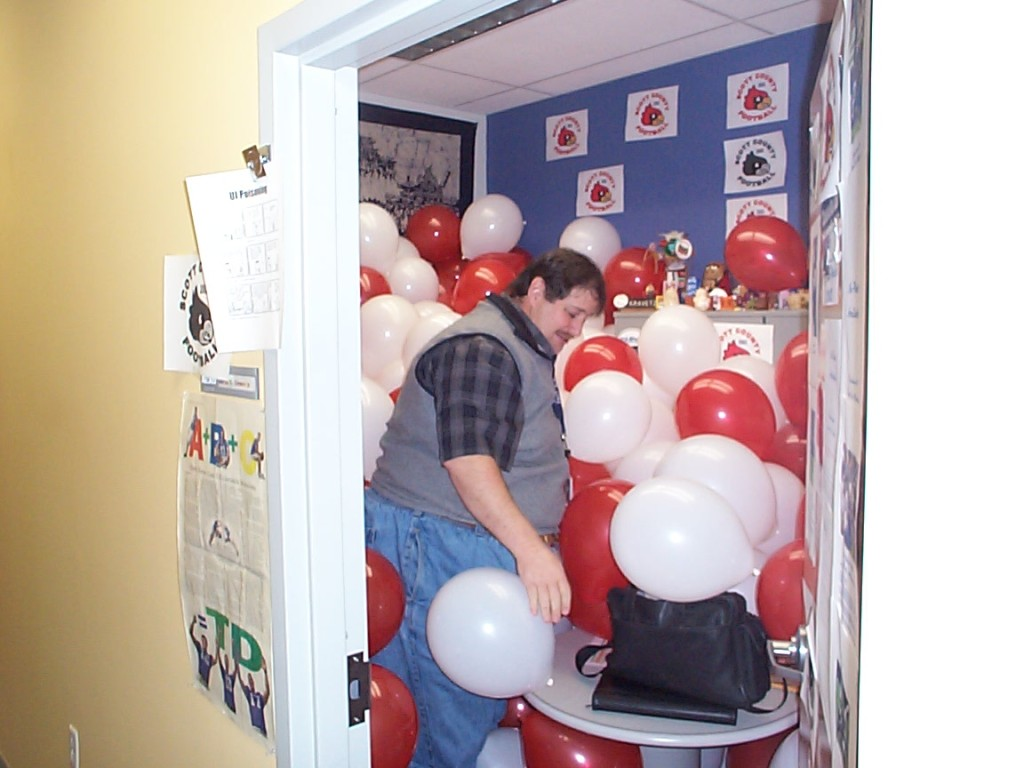 David at Lexmark office after losing a bet on a high school football game
